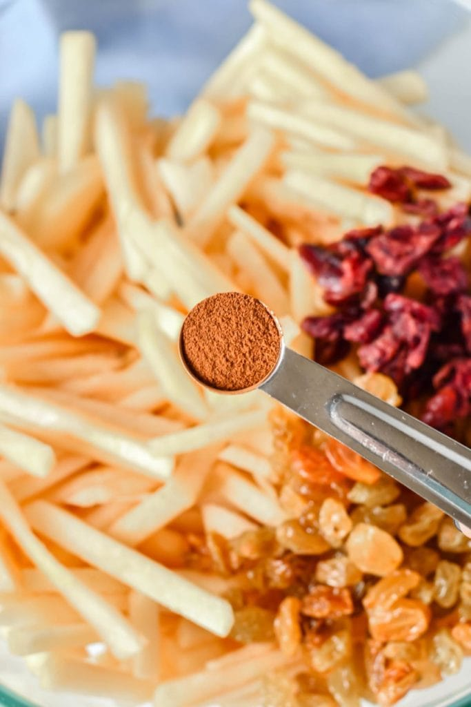 This Apple Pear Slaw with Caramel Cider Vinaigrette is the perfect fruit salad for fall. Compete with a savory-sweet mix of apples, pears, cranberries and raisins tossed in caramel cider vinaigrette, this slaw is heavenly.