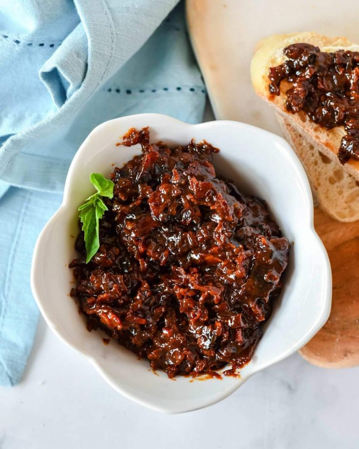 This bacon jam recipe is about to change your life for the best (literally the best you'll ever have). Spread it on toast, use it as a burger topping or savor the flavor crackers. You'll never go back to plain old jam again!