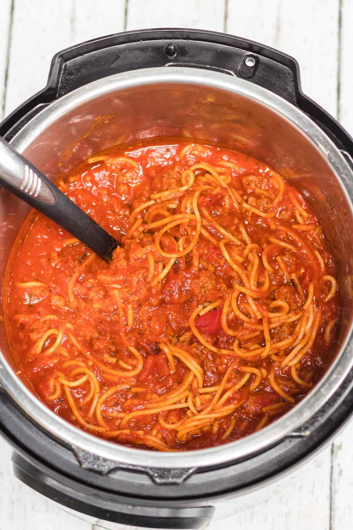 This Instant Pot Spaghetti and Meatballs Recipe is a delicious one-pot meal that the entire family will love. This delicious dinner will be ready in under 30 minutes!