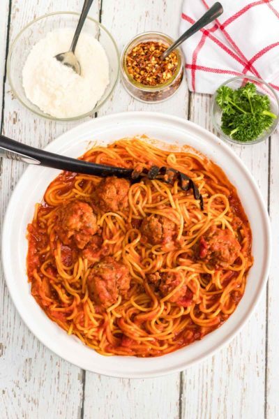 This instant pot spaghetti and meatballs is an easy one-pot recipe with mouth-watering homemade meatballs.