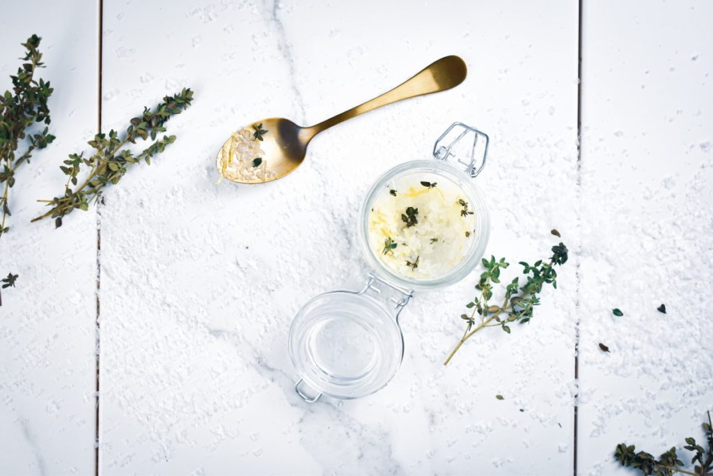 Make this homemade DIY lemon thyme salt scrub with just 4 ingredients for glowing skin. Gently exfoliate, nourish and moisturize skin.