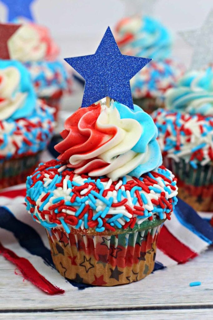 Patriotic Red, White and Blue Cupcakes - This easy to make festive cupcake recipe is perfect for celebrating 4th of July festivities and even Memorial Day. These cupcakes are soft, tasty and easy to make. These yummy 4th of July treats will become your favorite July 4th dessert. #4thofjuly #july4th