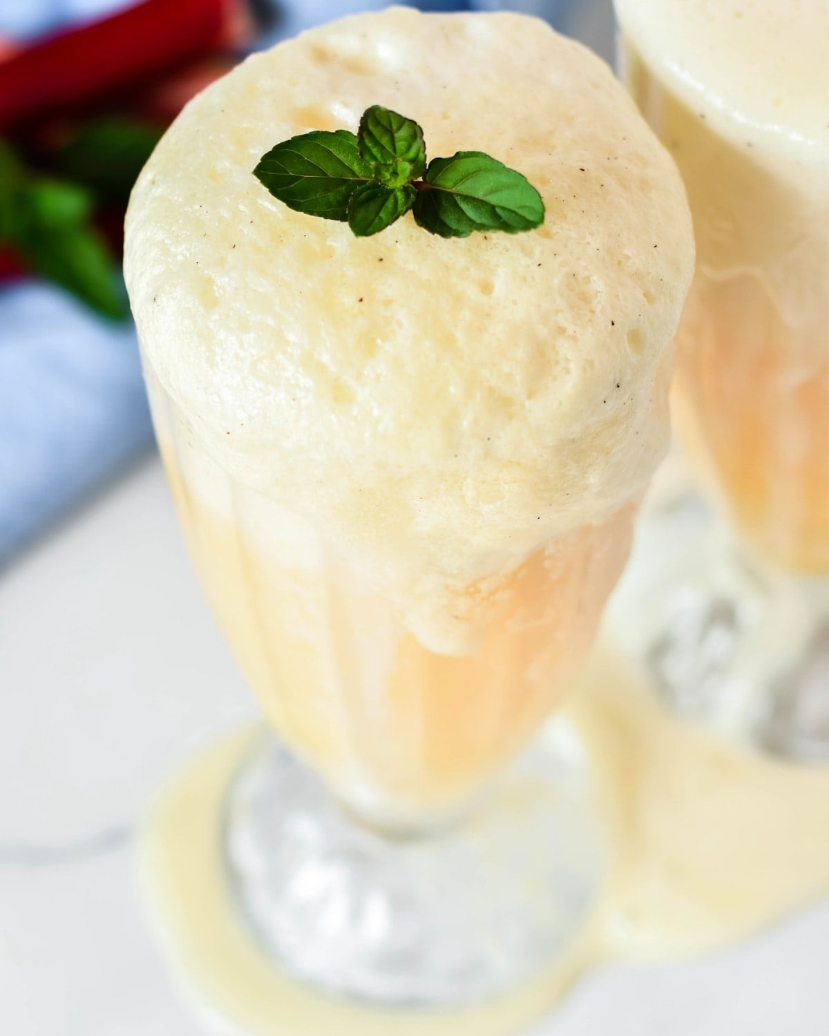 Boozy Elderflower Liqueur, fresh orange juice and ice cream! These boozy rhubarb elderflower ice cream floats are simple and wonderfully satisfying on a hot summer's day.