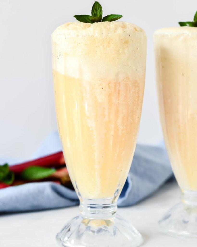 Boozy Elderflower Liqueur, fresh orange juice and ice cream! These boozy rhubarb elderflower ice cream floats are simple and wonderfully satisfying on a hot summer's day.