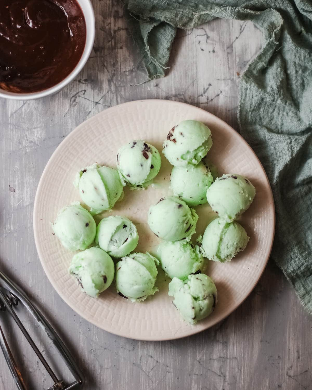 These Mint Chip Ice Cream Bon Bons are homemade ice cream bites covered with chocolate and way better than the ones in the freezer aisle.