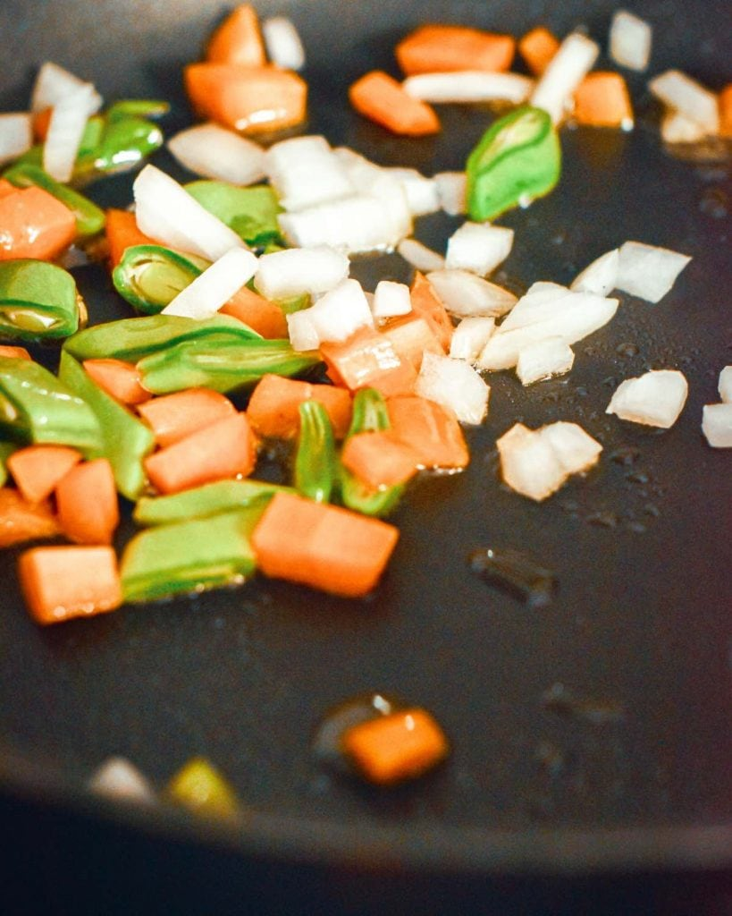 Overcooking the vegetables is not desirable for Nigerian Fried Rice